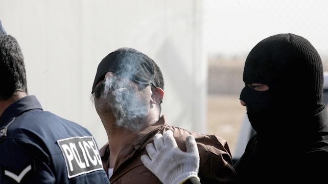A man smokes his last cigarette before being hanged for murder on April 1,2013