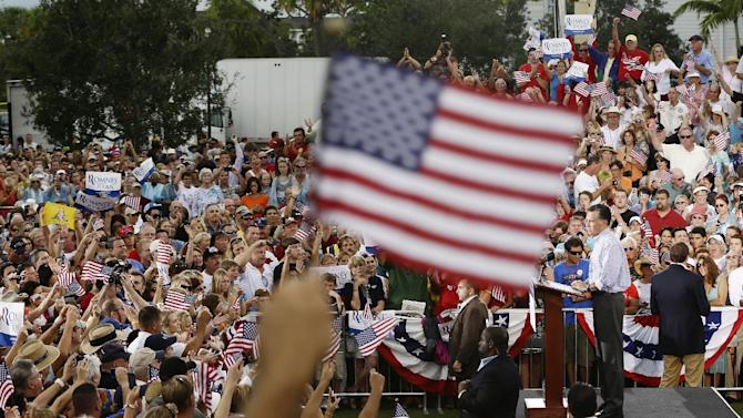 Republican presidential candidate and former Massachusetts Gov. Mitt Romney campaigns at Tradition Town Square in Port St. Lucie, Fla., Sunday, Oct. 7, 2012. (AP Photo/Charles Dharapak)