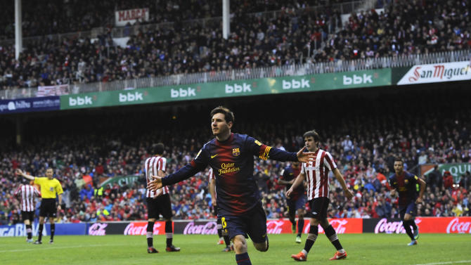 FC Barcelona's Lionel Messi from Argentina, celebrates after scoring against Athletic Bilbao during their Spanish League soccer match, at San Mames stadium in Bilbao, northern Spain, Saturday, April 27, 2013. (AP Photo/Alvaro Barrientos)