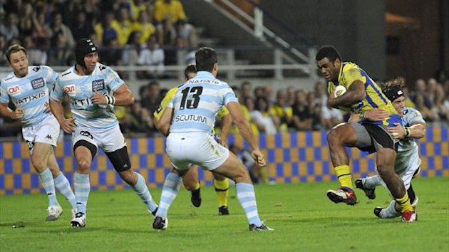 Clermont's Fidji winger Napolioni Nalaga (2ndR) tries to escape the tackle from a player of Racing during the French Top 14 rugby Union match (AFP)