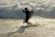 This file illustration photo shows a surfer at Injidup Beach, in the south-west corner of Western Australia. A surfer was apparently bitten to death by a shark off Australia&#39;s west coast on Saturday, police said, the fifth such fatal attack in the region in less than a year