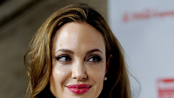 """FILE - This March 8, 2012 file photo shows actress Angelina Jolie at the Women in the World Summit in New York. Jolie says that she has had a preventive double mastectomy after learning she carried a gene that made it extremely likely she would get breast cancer. The Oscar-winning actress and partner to Brad Pitt made the announcement in  an op-ed she authored for Tuesday's New York Times under the headline, """"My Medical Choice."""" She writes that between early February and late April she completed three months of surgical procedures to remove both breasts.  (AP Photo/Evan Agostini, file)"""