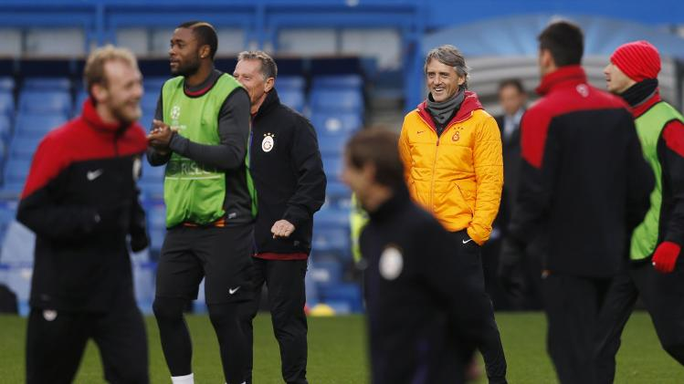 Galatasaray's Manager Mancini watches a training session at Stamford Bridge in London
