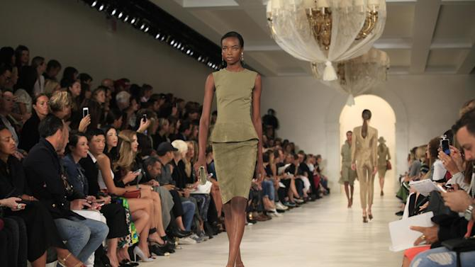 A model presents a creation by Ralph Lauren during Mercedes-Benz Fashion Week Spring 2015 at The Pavilion of Lincoln Center in New York.