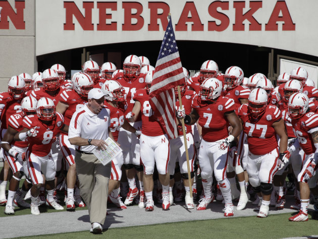 Nebraska's head coach Bo Pelini leads his squad onto the playing field prior to their NCAA college football game against Arkansas State in Lincoln, Neb., Saturday, Sept. 15, 2012. (AP Photo/Nati Harni