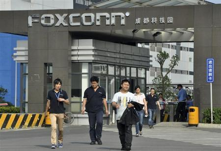 Workers walk out of the entrance to a Foxconn factory in Chengdu