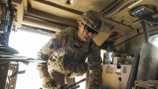 A U.S. soldier from Dragon Company of the 3rd Cavalry Regiment prepares for a mission on forward operating base Gamberi in the Laghman province of Afghanistan