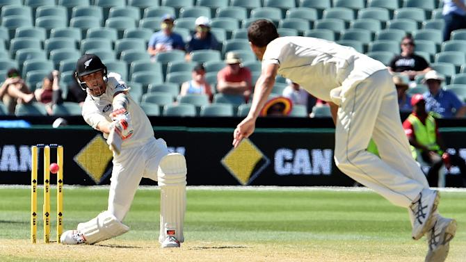 New Zealand batsman Trent Boult (L) is clean bowled off Australia paceman Jash Hazlewood during the third day of the day-night Test at the Adelaide Oval on November 29, 2015