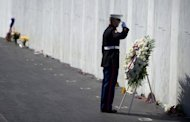 A Marine Honor Guard lays a wreath in front of the Wall of Names at the Flight 93 National Memorial during observances commemorating the eleventh anniversary of the 9/11 attacks in Shanksville, Pennsylvania