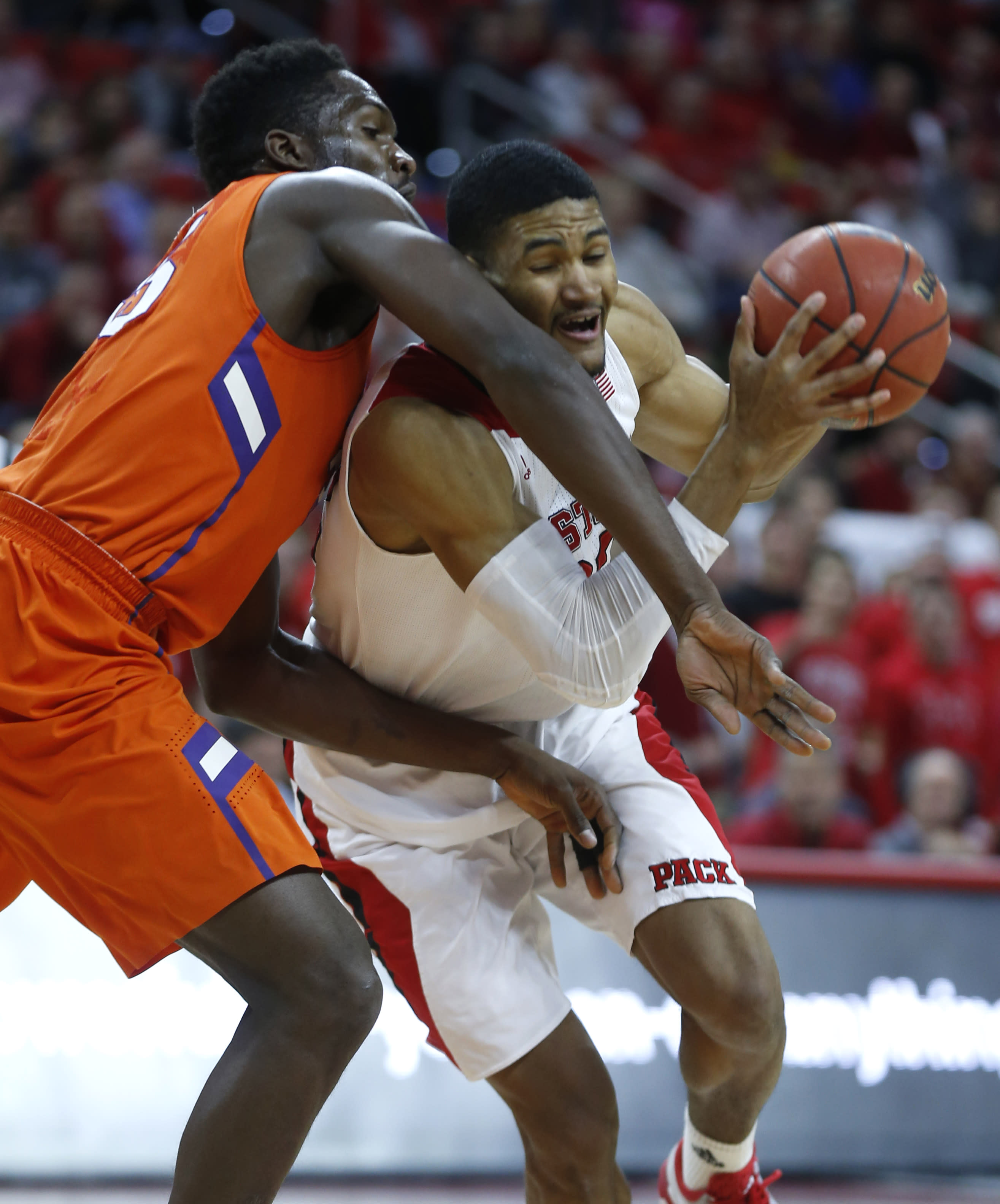 Clemson builds big 1st-half lead, holds off NC State 68-57