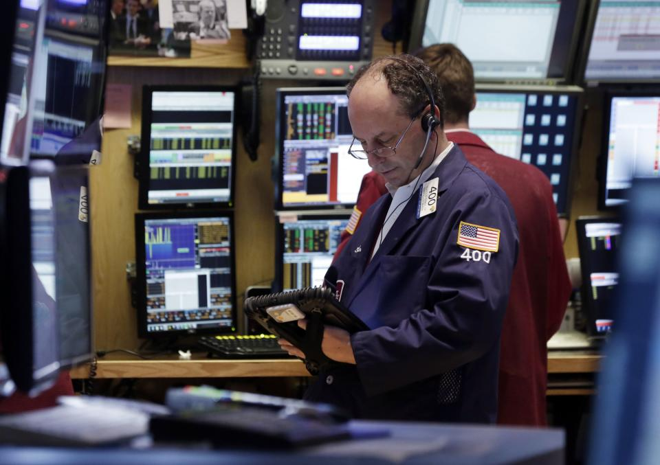 Trader Gordon Charlop works on the floor of the New York Stock Exchange Friday, July 5, 2013. Robust hiring in the U.S. is boosting the stock market in early trading. (AP Photo/Richard Drew)