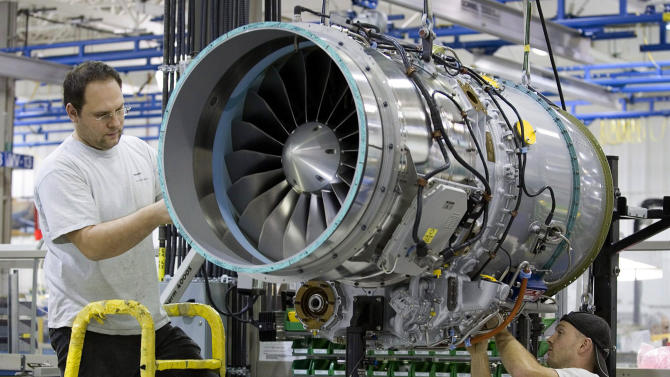 FILE -- In this Dec. 13, 2006 file photo, workers assemble a PW500 engine destined for a Cesna Citation at the Pratt & Whitney plant in Longueuil, Quebec, Canada. Sale of private jets, like the Citation, are rising again in 2014 after the deep recession when the company plane was an easy target for spending cuts. Pratt & Whitney Canada laid off more than 400 workers in 2009 and 2010. But company president Paul Adams said in May 2014 that improvements in the top part of the business have driven the market's recovery, (AP Photo/The Canadian Press, Paul Chiasson, File)