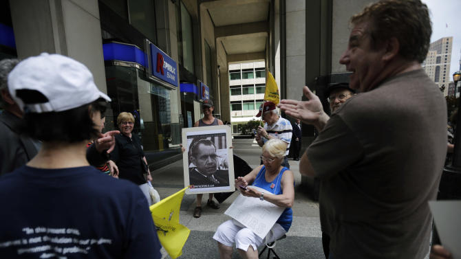 Protesters gather during a tea party rally against the extra IRS scrutiny of their groups., Tuesday, May 21, 2013, in Philadelphia. Tea party groups and other groups are urging activists across the country to demonstrate at their local Internal Revenue Service offices. (AP Photo/Matt Slocum)