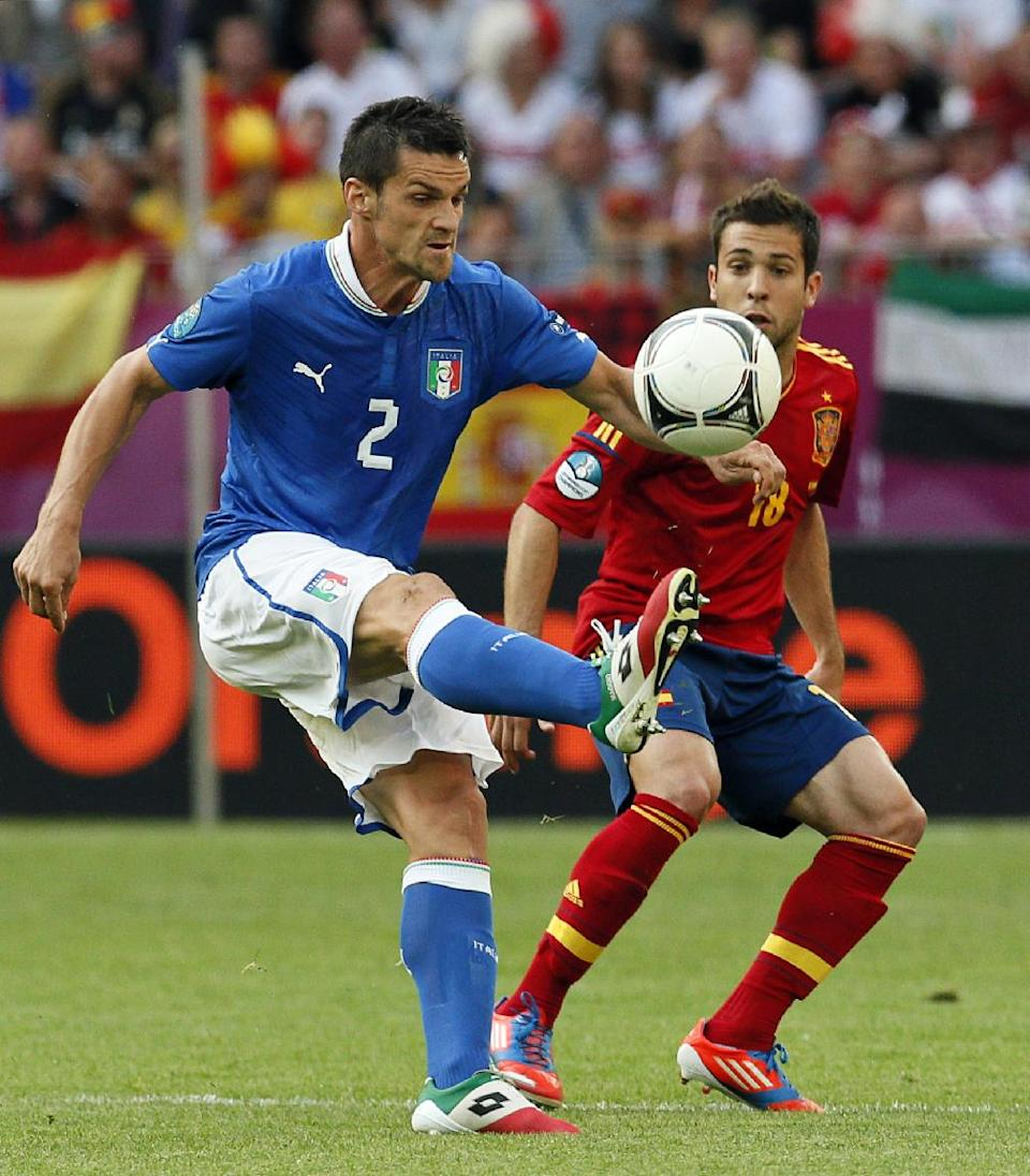 Italy's Cristian Maggio kicks the ball in front of Spain's Jordi Alba during the Euro 2012 soccer championship Group C match between  Spain and Italy in Gdansk, Poland, Sunday, June 10, 2012. (AP Photo/Michael Sohn)