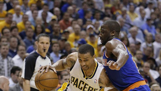 Indiana Pacers' George Hill goes to the basket against New York Knicks' Raymond Felton during the second half of Game 4 of an Eastern Conference semifinal NBA basketball playoff series, on Tuesday, May 14, 2013, in Indianapolis. Indiana defeated New York 93-82. (AP Photo/Darron Cummings)