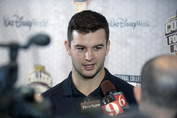 Alabama quarterback AJ McCarron answers questions during a media availability prior to the College Football Awards show in Lake Buena Vista, Fla., Wednesday, Dec. 11, 2013