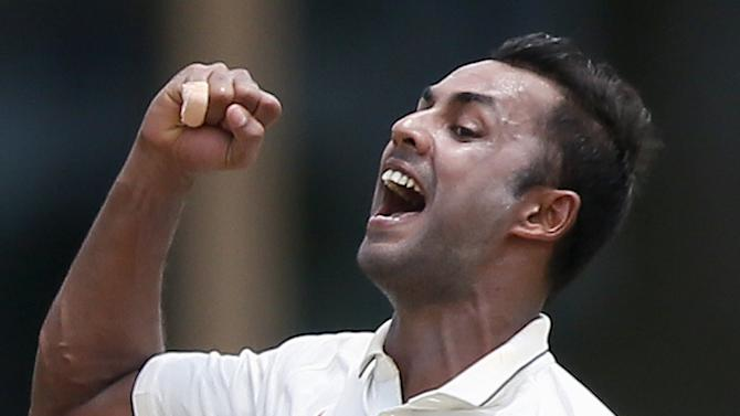 India's Binny celebrates after taking the wicket of Sri Lanka's Chandimal during the third day of their third and final test cricket match in Colombo
