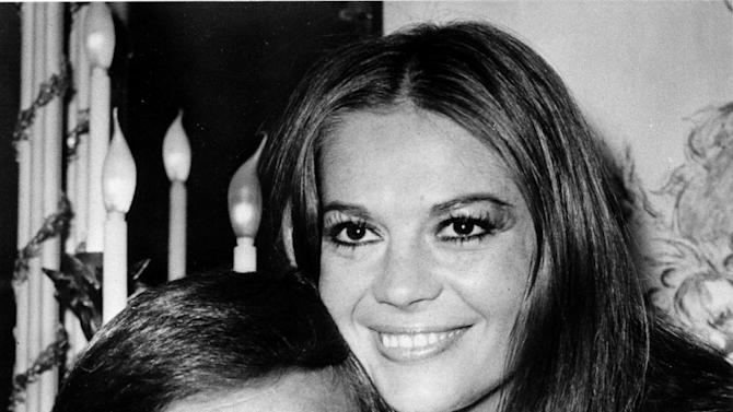 "FILE - In this April 23, 1972 file photo, actor Robert Wagner and his former wife, actress Natalie Wood, pose at the Dorchester Hotel in London, England.  Authorities amended Wood's death certificate on Aug. 1, 2012 to reflect some of the lingering questions about how the actress died in the waters off Catalina Island in November 1981. The changes include altering her cause of death to ""Drowning and other undetermined factors"" and adding the statement ""Circumstances not clearly established"" to how Wood ended up in the water while on a yacht with husband Robert Wagner and actor and co-star Christopher Walken. (AP File Photo)"