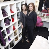 Lisa Frantz and Lydia Marks show off their replica closet and a whole lotta handbags. Photo courtesy of NY Post.