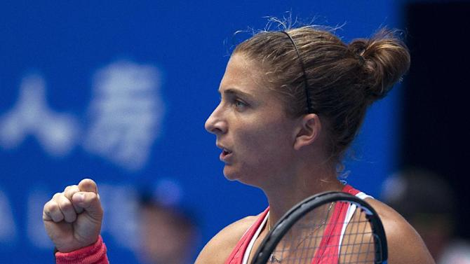 Sara Errani of Italy reacts after scoring a point against Petra Kvitova of the Czech Republic during their first round match of the China Open tennis tournament at the National Tennis Stadium in Beijing, Sunday, Oct. 4, 2015. (AP Photo/Andy Wong)
