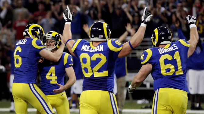 St. Louis Rams kicker Greg Zuerlein (4) is congratulated by Johnny Hekker, left, after making a 54-yard field goal to defeat the San Francisco 49ers 16-13 in overtime of an NFL football game, Sunday, Dec. 2, 2012, in St. Louis. Running past are Rams' Matthew Mulligan (82) and Tim Barnes (61). (AP Photo/Tom Gannam)