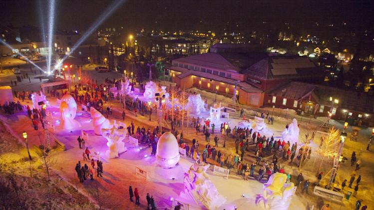 IMAGE DISTRIBUTED FOR BRECKENRIDGE RESORT CHAMBER- This evening aerial photograph shows colored lights on 15 snow sculptures as hundreds of people flock the outdoor gallery at the Riverwalk Center during the 23 annual International Snow Sculpture Championships in Breckenridge, Colo., on Saturday, Jan. 26, 2013. Each sculpture started out of a 12 foot tall, 20-ton block of compacted snow at the outdoor art gallery. The sculptures will remain on display through Feb. 3, 2013, weather permitting. Visit www.gobreck.com for more information. (Nathan Bilow / AP Images for the Breckenridge Resort Chamber)