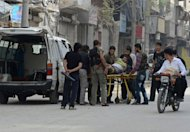 Syrians wheel a wounded civilian into a hospital, in the northern city of Aleppo
