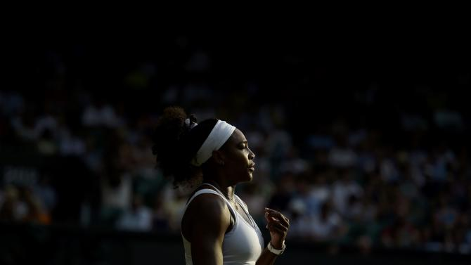 Serena Williams of the U.S.A. waits to return serve during her match against Timea Babos of Hungary at the Wimbledon Tennis Championships in London