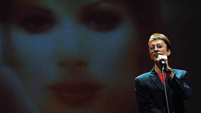 FILE - In this March 1, 2008, file photo, musician Robin Gibb performs at the Dubai International Jazz Festival in Dubai Media City Amphitheater, Dubai, United Arab Emirates. A representative said on Sunday, May 20, 2012, that Gibb has died at the age of 62. (AP Photo/Tracy Brand, File)