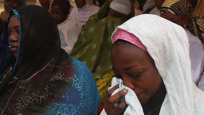 A young relative weeps during a memorial service for the 64 people killed in a New Year's stampede, as family members came to claim the bodies of their loved ones at Treichville's University Hospital Center morgue, in Abidjan, Ivory Coast, Wednesday, Jan. 9, 2013.  Officials said Saturday that the New Year's stampede was caused by a combination of several factors including unofficial tree trunk barricades, the narrowing of a major thoroughfare, bad lighting and a shortage of police officers.(AP Photo/Emanuel Ekra)