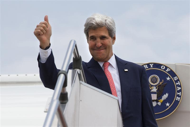U.S. Secretary of State Kerry makes the thumbs up sign as he leaves, after completing his trip to Malaysia, from Subang TUDM outside of Kuala Lumpur