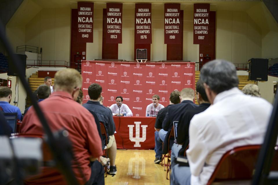 Indiana men's basketball coach Tom Crean, center left, listens as forward Cody Zeller speaks at a news conference where Zeller announced he will enter the NBA draft, at Assembly Hall in Bloomington, Ind., Wednesday, April 10, 2013. (AP Photo/The Herald-Times, Chris Howell)