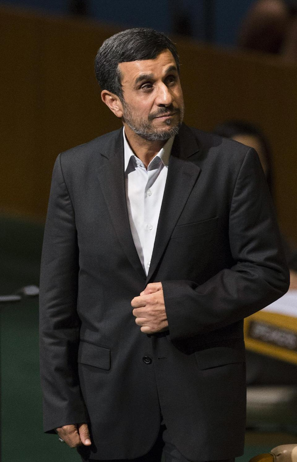 Iranian President Mahmoud Ahmadinejad approaches the podium before addressing the 67th United Nations General Assembly, at U.N. headquarters, Wednesday, Sept. 26, 2012. (AP Photo/John Minchillo)