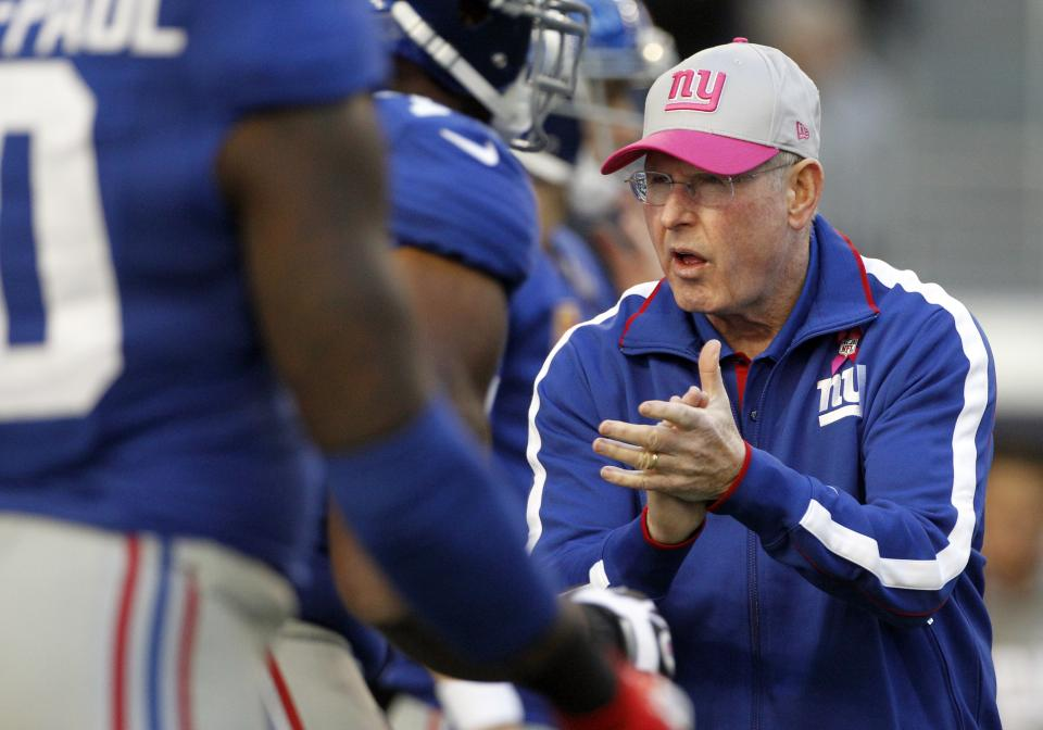 New York Giants head coach Tom Coughlin cheers his team before an NFL football game against the Dallas Cowboys, Sunday, Oct. 28, 2012, in Arlington, Texas. (AP Photo/Tony Gutierrez)