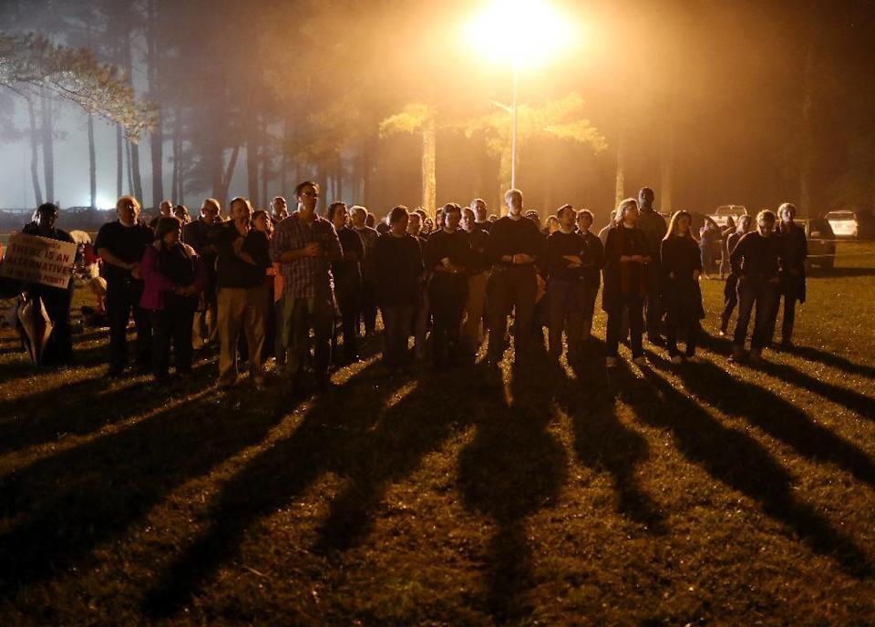Protesters sing outside of Georgia Diagnostic Prison in Jackson, Ga., Tuesday, Sept. 29, 2015, before the scheduled execution of Kelly Renee...