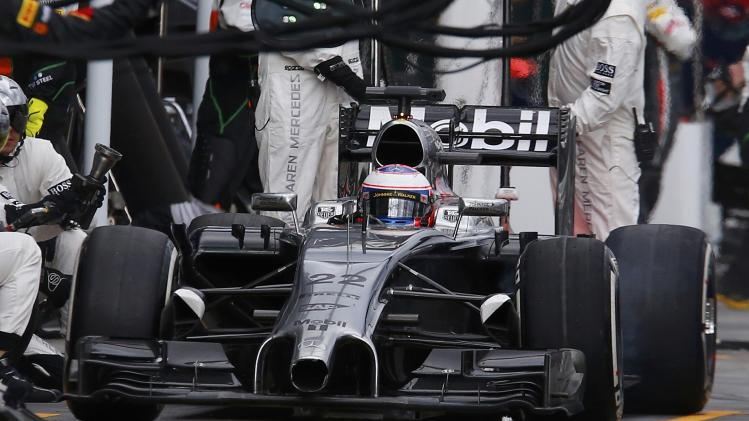McLaren Formula One driver Button of Britain makes a pit-stop at the Australian F1 Grand Prix in Melbourne