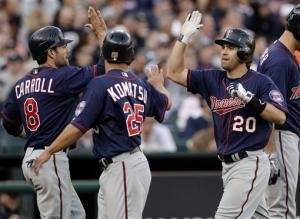 Twins beat sloppy Tigers 11-7
