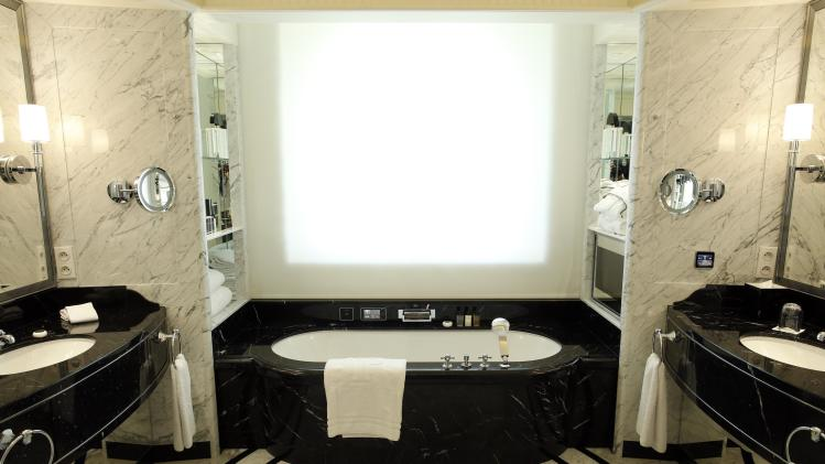 View of a marble bathroom in a room at the Peninsula Paris luxury hotel in Paris