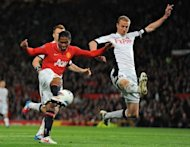Fulham's Norwegian defender Brede Hangeland (R) vies with Manchester United's Ecuador midfielder Antonio Valencia during the English Premier League football match between Manchester United and Fulham at Old Trafford in Manchester. United won 1-0