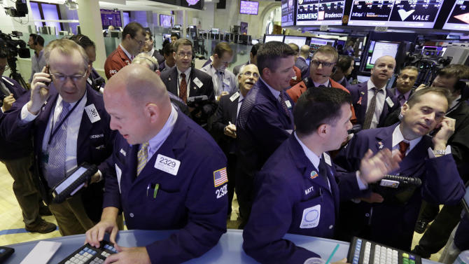 Traders gather at posts on the floor of the New York Stock Exchange Wednesday, June 19, 2013. Stocks edged lower in early trading on Wall Street Wednesday as investors waited for word from the Federal Reserve. (AP Photo/Richard Drew)