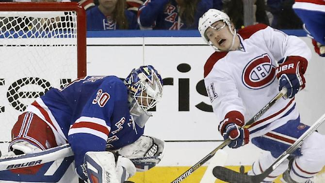Montreal Canadiens right wing Brendan Gallagher (11) takes a shot as New York Rangers goalie Henrik Lundqvist (30) of Sweden makes a save in the second period of Game 3 of the NHL hockey Stanley Cup playoffs Eastern Conference finals, Thursday, May 22, 2014, in New York