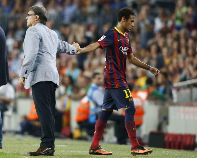 Barcelona's coach Martino shakes hands with Neymar after his substitution during their Spanish First division soccer league match against Real Sociedad in Barcelona