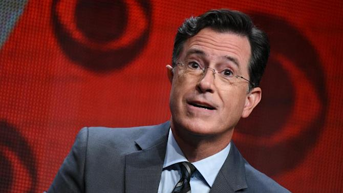 "FILE - In this Aug. 10, 2015, file photo, Stephen Colbert participates in ""The Late Show with Stephen Colbert"" segment of the CBS Summer TCA Tour in Beverly Hills, Calif. Vice President Joe Biden will be among Colbert's first guests on ""The Late Show."" CBS announced Tuesday, Sept. 1, 2015, that Biden will join previously announced guests Uber CEO Travis Kalanick and country singer Toby Keith on Sept. 10.  (Photo by Richard Shotwell/Invision/AP, File)"