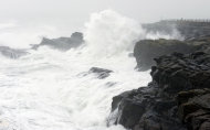 High winds whip surf and spray at Boiler Bay State Scenic Viewpoint, north of Depot Bay, Ore., Monday, Nov. 19, 2012. Residents in Washington and Oregon are bracing for expected river flooding after heavy rain and winds that caused sporadic road closures, power outages and at least one death. The wet weather is expected to continue throughout the week, after hurricane-strength winds battered both states along the coast. (AP Photo/The Oregonian, Brent Wojahn)