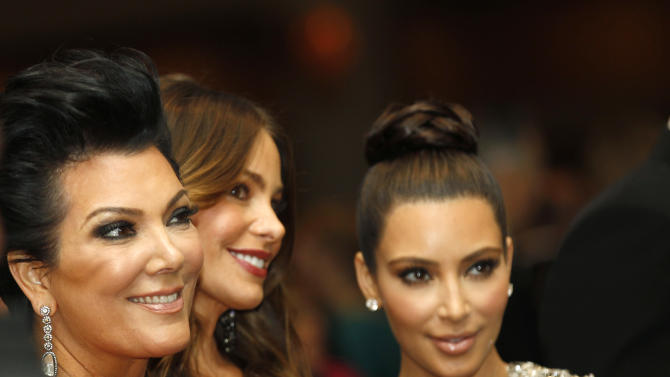 Kris Jenner, left, with Sofia Vergara, center, and Kim Kardashian during the White House Correspondents' Association Dinner headlined by late-night comic Jimmy Kimmel, Saturday, April 28, 2012 in Washington. (AP Photo/Haraz N. Ghanbari)