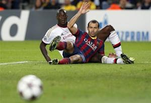 AC Milan's Balotelli and Barcelona's Mascherano react during their Champions League soccer match in Barcelona