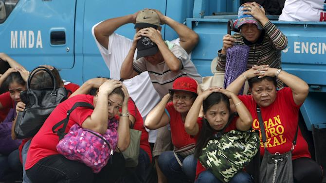 Residents take part in an earthquake drill outside a hospital in Quezon city