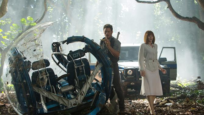 "This photo provided by Universal Pictures shows, Chris Pratt, left, and Bryce Dallas Howard in a scene from the film, ""Jurassic World,"" directed by Colin Trevorrow, in the next installment of Steven Spielberg's groundbreaking ""Jurassic Park"" series.  (Chuck Zlotnick/Universal Pictures via AP)"