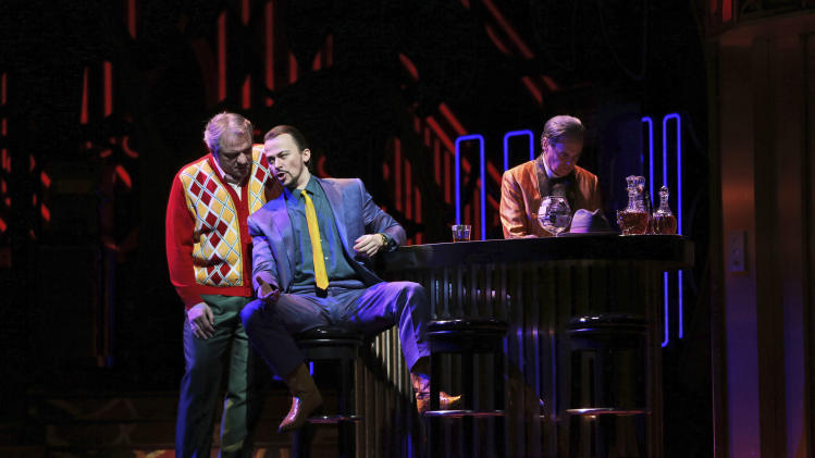 In this Friday, Jan. 25 2013 photo, Zeljko Lucic, left, performs the title roll alongside Stefan Kocan performing as Sparafucile during the final dress rehearsal of Giuseppe Verdi's Rigoletto at the Metropolitan Opera in New York.  (AP Photo/Mary Altaffer)