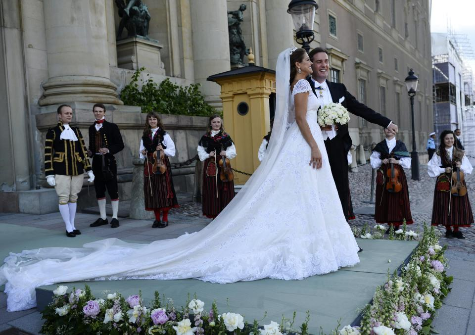 Princess Madeleine and her husband Christopher O'Neill, stand outside the Royal Chapel after the irwedding ceremony in Stockholm , Saturday, June 8, 2013. (AP Photo/Scanpix Sweden, Leif R Jansson)   SWEDEN OUT